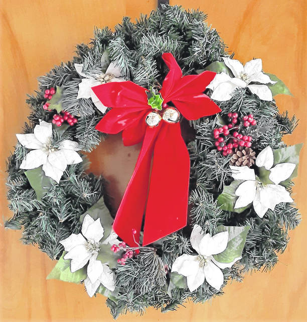 Carols and a wreath help make the Christmas season bright.