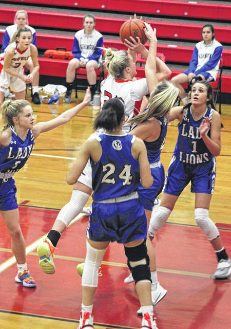 Fairfield junior Braylynn Haines puts up a contested shot during a non-conference victory Monday against the Washington Lady Blue Lions.
