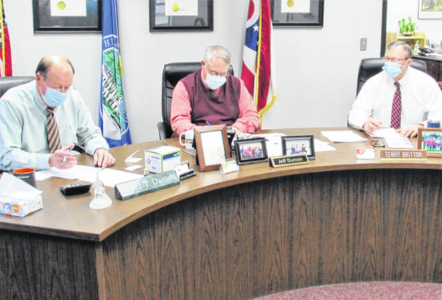 Highland County commissioners (l-r) David Daniels, Jeff Duncan and Terry Britton are pictured during Monday's organizational meeting.