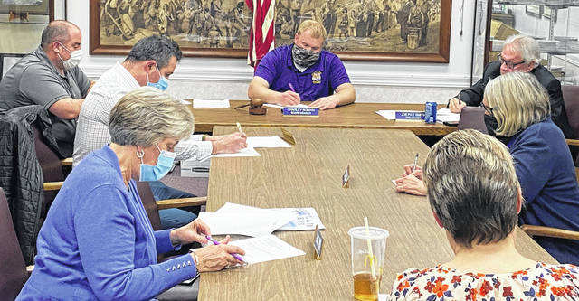 Pictured at Thursday's meeting are (clockwise from bottom left) Greenfield Exempted Village Board of Education members Sandy Free, Eric Zint, Eric Wise and Charley Roman; district treasurer Joe Smith; and board member Marilyn Mitchell. In the foreground is superintendent Quincey Gray.