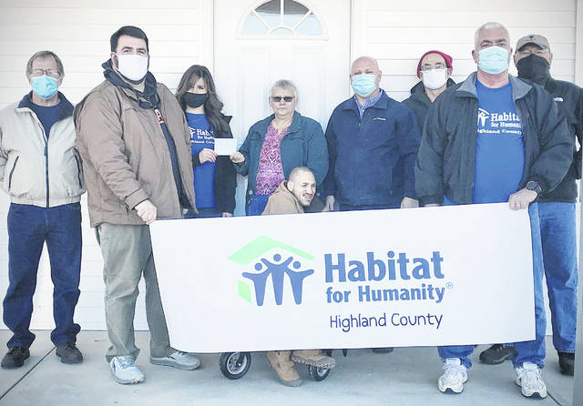Pictured (l-r) are Habitat for Humanity Highland County board members Daryl Mount and Chris Osborne; executive director Kelli Rosselott; new homeowners Kathy and Myles Burns; Habitat Board President Richard Warner; David Collins CPA;and Habitat board members Steve Conrad and Dave Minton. Not pictured are Habitat board members Denny Kirk and Marc Bayless.