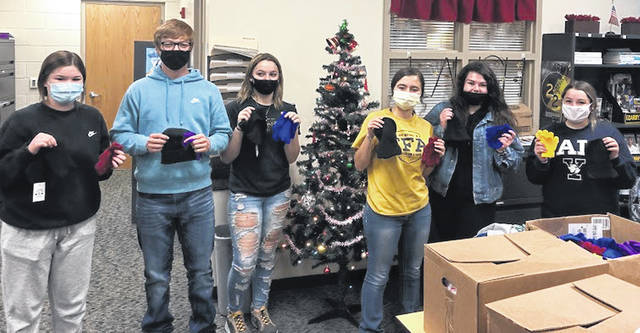 Pictured (l-r) are Alexis Swayne, Ben Remsing, Zamarah Thompson, Jessica Howland, Maddie Curtis and Mackenzie Pointer packing the hats and gloves for students to take home.