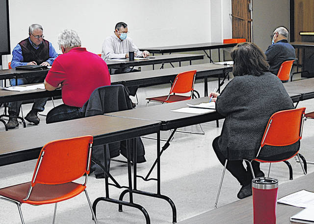 Highland County commissioners Jeff Duncan (left) and Terry Britton (right) set at the head table during a Thursday meeting of the Highland County Land Reutilization Corporation.