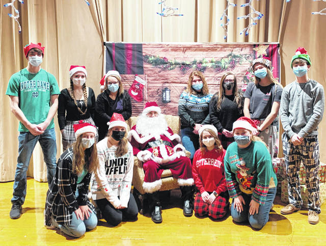 On Dec. 18, the McClain FFA Chapter hosted a Children's Christmas for all of the Greenfield Elementary students. The McClain officer team transformed the high school auditorium into Santa's Workshop and all the students were able to come over and visit with Santa. The FFA asked for a $2 donation for the kids to get a picture with Santa and all the funds were used to purchase gifts for children's Christmas shopping. After having their picture taken with Santa, the kids went over and told the elves what they wanted for Christmas and received a candy cane.