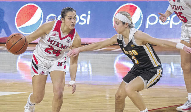 Lynchburg-Clay High School product Peyton Scott (left) is averaging 19 points, seven rebounds and five assists per game in her sophomore season at Miami University.