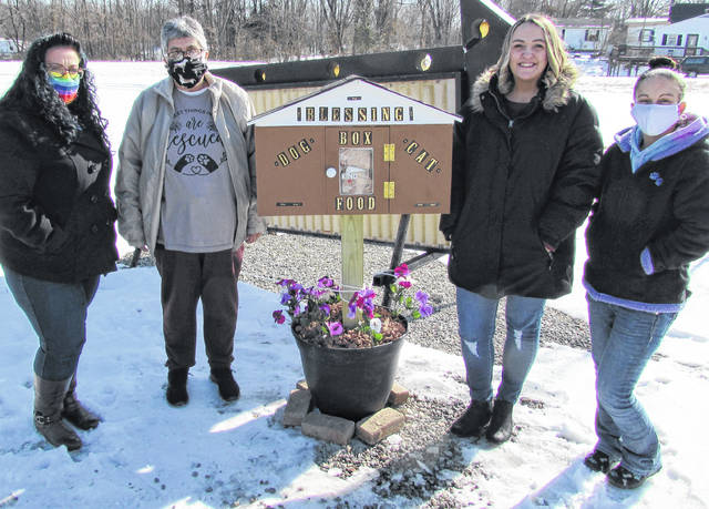 Standing near the new community Blessing Box for pets at Stephanie's Pet Spa & Pet Center in Hillsboro are (l-r) Christi Hauke, president of the Highland County Humane Society board; society members Sally Hinton and Sarah Roe; and Humane Society Shelter Manager Megan Wolf.