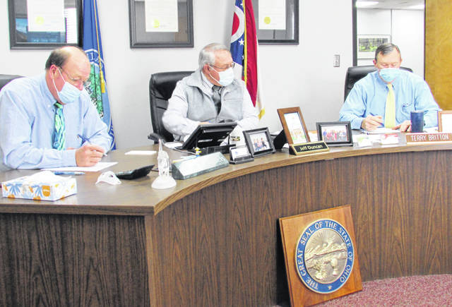 Shown (l-r) are commissioners David Daniels, Jeff Duncan and Terry Britton during Wednesday's board meeting.