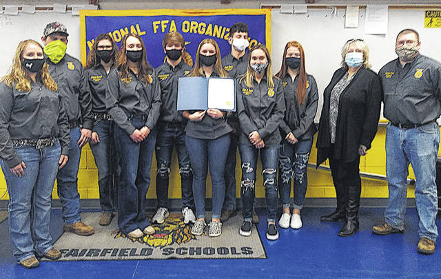 The Fairfield FFA kicked off National FFA Week with Leesburg Mayor Shawn Priest officially declaring it National FFA Week. Pictured is the Fairfield officer team and advisors. Pictured (l-r) are advisor Kelsey Dickey, Caden Shoemaker, Shaleigh Duncan, Sydney Sanders, Brayden Zimmerman, Harley Flint, Reese Teeters, Kiley Lamb, Allyce McBee, Mayor Shawn Priest and advisor Daniel Foster.