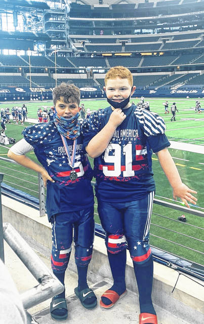 Two Hillsboro youth football players participated in the Football America, Red White & Blue Showcase on Jan. 30. The game was held at AT&T Stadium, the home field for the Dallas Cowboys. Andrew Couch (left) and Ryker Snyder both played for the Blue 8-9 years and under team.