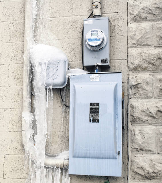 This photo shows water that has frozen on a wall behind The Times-Gazette offices.