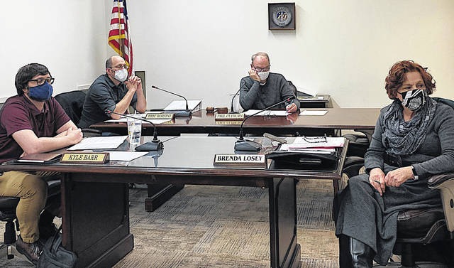 Greenfield Village Council members are pictured during this week's regular meeting. Shown (l-r) are Kyle Barr, Eric Borsini, Phil Clyburn and Brenda Losey.