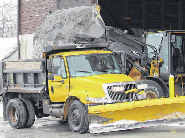 A Jackson Township vehicle is loaded with a mixture to fight ice and snow Thursday at the Highland County Engineer's Office.