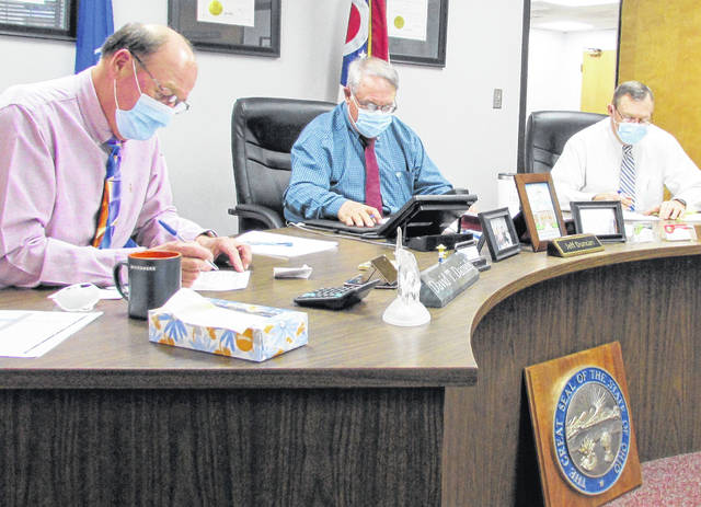 Pictured (l-r) are commissioners David Daniels, Jeff Duncan and Terry Britton at Wednesday's meeting.