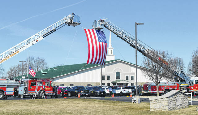The Wilmington Fire Department provided the flag and crossed ladders tribute to ONDR Officer Jason Lagore Wednesday morning at Bible Baptist Church in Wilmington.