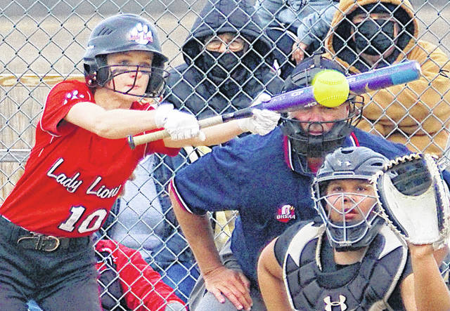 The Fairfield Lions Lions defeated Wilmington 8-7 in a non-conference contest Saturday. In one photo Halle Hamilton (10) attempts to lay down a bunt. In the other photo Kylie Fauber takes a swing.
