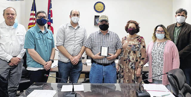 Rod Halterman (center), Greenfield's March Citizen of the Month, is pictured with (l-r) Greenfield council members Phil Clyburn, Kyle Barr, Eric Borsini, Brenda Losey, Amie Ernst and city manager Todd Wilkin at this week's council meeting.
