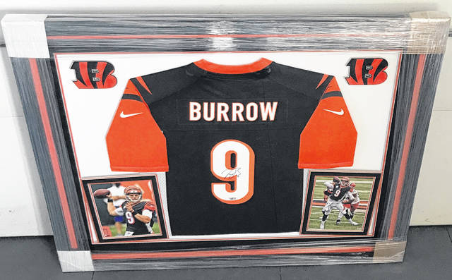 This autographed Joe Burrow jersey and pictures will be auctioned off at the annual SATH Celebrity Golf Classic on April 26.
