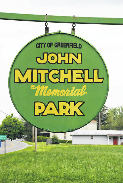 This file photo shows a sign at the entrance to Mitchell Park in Greenfield.