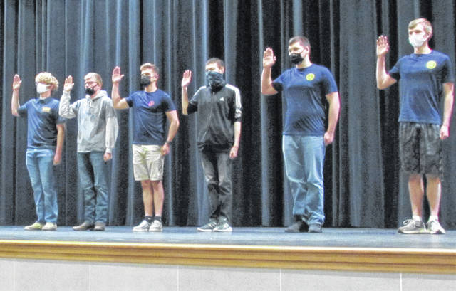A total of eight Hillsboro High School students will be entering the military upon graduation, with six of them publicly affirming by oath their intention to protect, defend and serve their country in the armed services. HHS graduate and Hillsboro Auditor and 1st Lt. Alex Butler of the U.S. Army Reserve administered the loyalty oath during the third annual Military Student Recognition ceremony held in the new HHS auditorium. Shown (l-r) are Justin Conn, who will be entering the Navy; U.S. Air Force recruit Scott Eastes; Zachary Fite and Motoki Remington, who both will enter the Marine Corps; and Derek Fraley and Owen Ryan, who have enlisted in the Navy. Fite made history of a sort, according to high school counselor Jessica Rhoades, when he became the first official graduating senior of the 2021 class by receiving his diploma Wednesday, the first and only student thus far to graduate from the stage of the new auditorium and the first graduate to wear Hillsboro's newly designed cap and gown. Not present during Wednesday's ceremonies were Rhen Williamson and Dakota Ballein, who have both enlisted in the U.S. Army. Rhoades said that Ballein, a junior, applied for and was granted early graduation credentials so he can ship out with the Army in December.