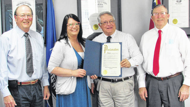 The Highland County Board of Commissioners issued a proclamation Wednesday designating April as Sexual Assault Awareness Month. Shown (l-r) are commissioner David Daniels, Alternatives to Violence Center Director Dara Gullette, commission chairman Jeff Duncan and vice-chairman Terry Britton.