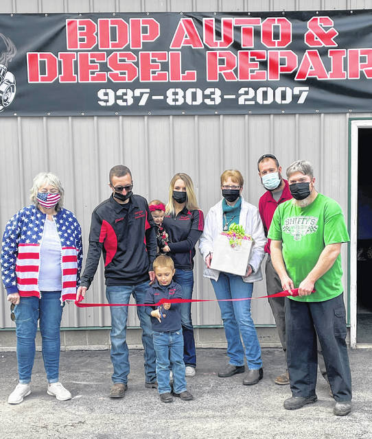 The village of Leesburg held a ribbon-cutting for DBP Diesel and Auto Repair, owned by Justin and Ashley Bailey, on April 23. The new business is located at 149 E. Main St., Leesburg. Formerly known as CR Automotive, BDP Auto and Diesel Repair works on gas and diesel engines. The business can be reached at 937-803-2007. Pictured (l-r) are Leesburg Mayor Shawn C. Priest, Justin Bailey, Ashley Bailey, Rita Smith-Daulton, Joel Morris and Chris Runyon.