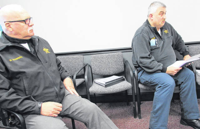 Shown are Highland County Sheriff Donnie Barrera (left) and Sgt. Scott Miller as they briefed commissioners Wednesday on the progress and operation of the county's emergency 9-1-1 dispatch system and personnel.