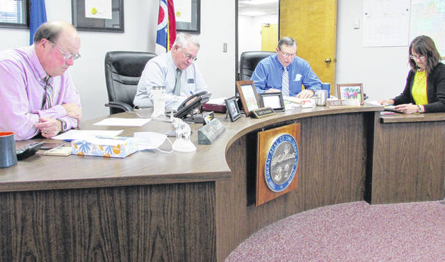 Shown (l-r) during Wednesday's meeting of the Highland County Board of Commissioners are David Daniels, chairman; Jeff Duncan, vice chair; Terry Britton and clerk Mary Remsing.