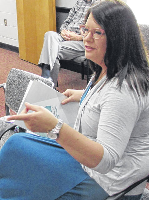 Dara Gullette, director of the Alternatives to Violence Center in Hillsboro, describes the activities of the organization during Wednesday's meeting of the Highland County commissioners.