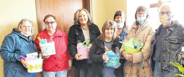 Members of Highland County Christian Women donated special Easter baskets to the Highland County Homeless Shelter in April. The baskets were received by Tammy Dennis, administrative director, and will go to several children currently living at the shelter. Pictured are members of Highland County Christian Women, a faith-based Christian organization whose purpose is to assist and aid the needs of county citizens. Women of all churches are invited to join. Workshops are held in the evening on the second Monday of the month at an area church building. The April workshop will be at Peace Lutheran Church on Harry Sauner Road at 6 p.m. For more information, contact group leader Judy Mason at 937-403-7885 or Sue Smith at 937-403-2294.