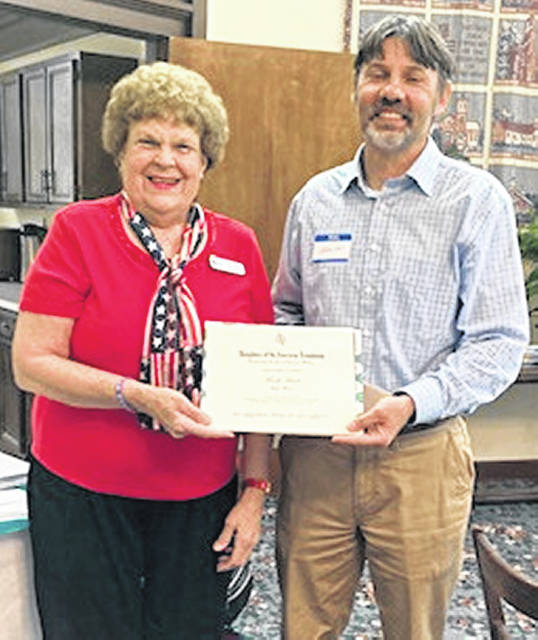 Waw-Wil-A-Way DAR Chapter Chaplain Janet Florence presents an Outstanding American History Teacher Certificate to Mark Faust of Lynchburg-Clay High School.