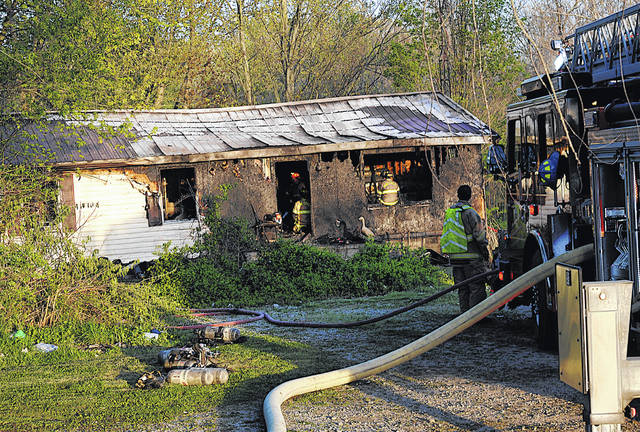 Firefighters remain at the scene of a blaze that destroyed a home Monday in the 4000 block of Concord Road in southern Highland County.