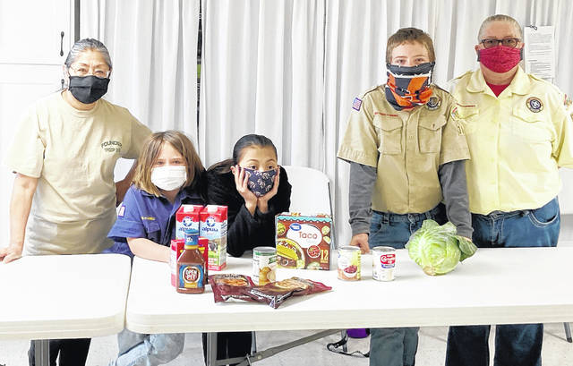 The Rainsboro United Methodist Church Charge Food Pantry is open the fourth Saturday of each month from 10 a.m. to noon for Paint and Marshall townships residents. In this picture Scouts from Pack 5316, Troop 5316 and Troop 7316 lend a hand at the food pantry.