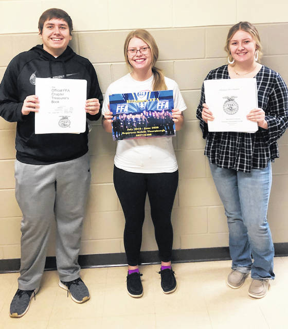 Pictured (l-r) are Ben Floera, Kelcie Thornburgh and Hannah Hopkins with their FFA officer books.
