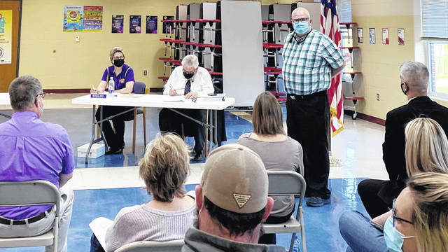 Buckskin Elementary Principal Mike Shumate (standing) speaks to those attending a Greenfield School Board meeting on Monday. Seated in the background are (l-r) superintendent Quincey Gray and district treasurer Joe Smith.
