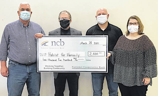 NCB recently maded a $2,500 donation to support Habitat for Humanity of Highland County. Pictured (l-r) are Habitat board members Steve Conrad and Daryl Mount, Habitat board president Richard Warner, and NCB's Kristy Warner.