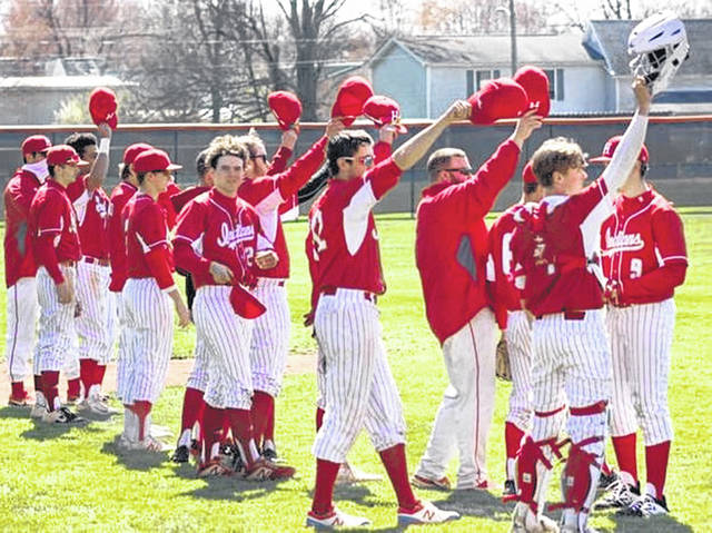 Hillsboro baseball team members tip their hats in Mowrystown on Saturday at the Wildcat Invitational.