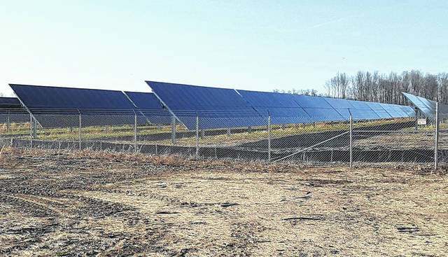 Solar panels reflected a clear blue sky Saturday at the nearly-completed Hillcrest solar panel farm just across the Brown County line near Buford. The first public hearing on the Ross County Solar project near Greenfield is scheduled for Tuesday at 6 p.m.