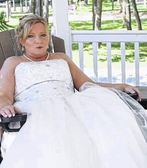 Kit Loch is pictured in the wedding dress she is offering as part of the Pay It Forward Wedding.