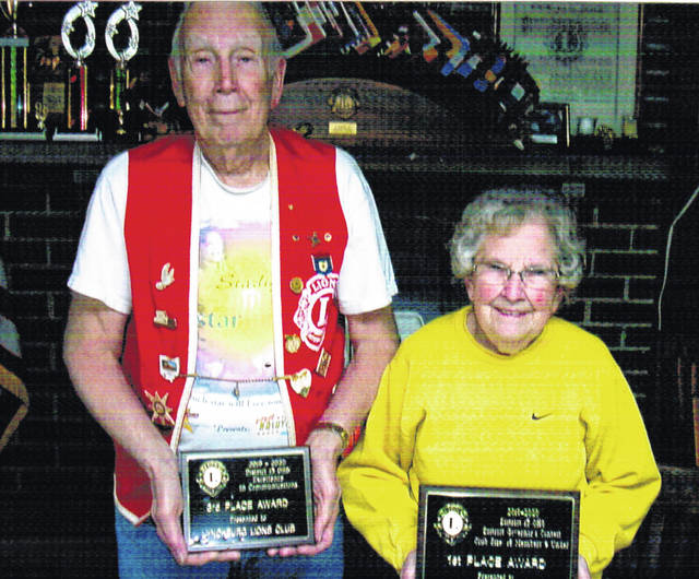 Pictured are Lynchburg Lions President Bob Roth (left) and Lion Virginia Rhonemus. They are pictured with the awards won by the Lynchburg club.