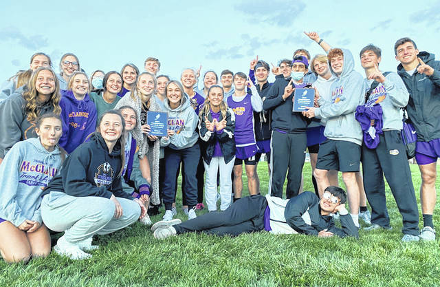 The McClain boys and girls track teams are pictured Friday after both teams took first place at the Washington C.H. Invitational.
