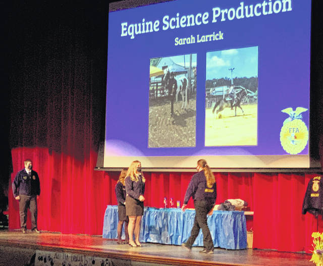 Pictured (l-r) are Jessica Howland, Ben Florea, Gracie Issacs and Hannah Hopkins passing out awards at the annual Hillsboro FFA Banquet and Sarah Larrick receiving the proficiency award for equine science.