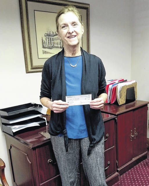Susan Davis is pictured with a check for her Soles for Students program that she received from the Hillsboro Women's Club. The club also recently made donations the Highland County Dog Pound, Hillsboro City Schools Tomahawk Food Truck and the Hillsboro After Prom Party.