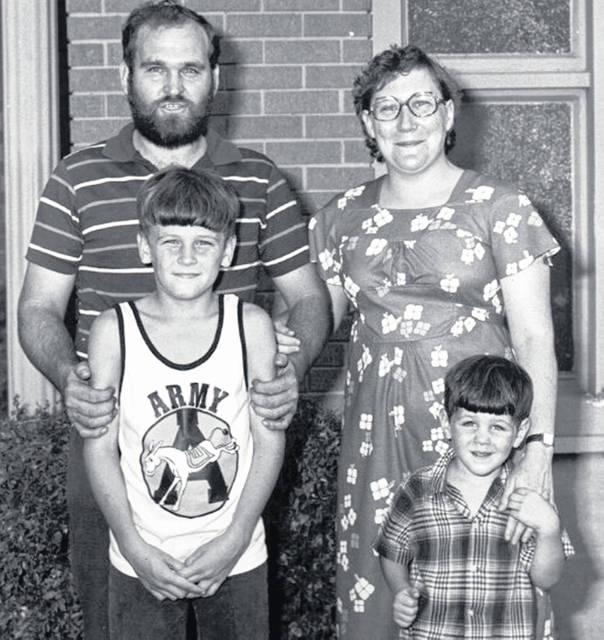 In this photograph a young Wade Tackett (front, left) is pictured with his parents, Virgil and Mary Tackett, and brother, Aaron Tackett.