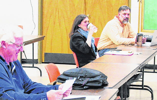 Mark Current (left) Highland County Community Action housing director; Hannh Bivens, Greenfield law director (center); and Greenfield City Manager Todd Wilkin are pictured at Thursday's land bank meeting.