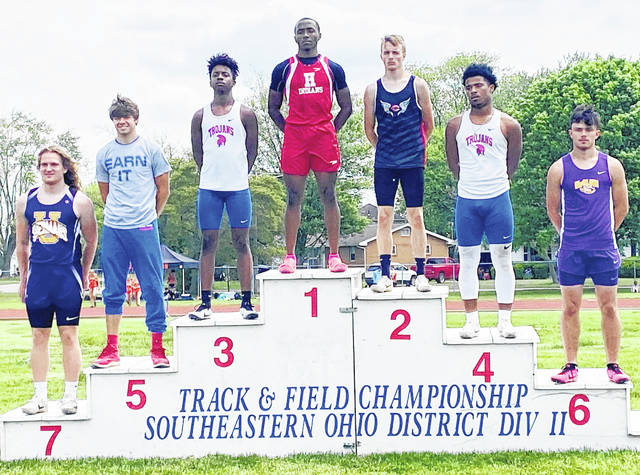 Hillsboro senior Kai Rickman, pictured here atop of the 100-meter podium, won the 100 meters, 200 meters and was a member of the winning 4 x 200-meter relay team last week at the Division II Southeast District Track and Field Meet at Washington C.H. Also pictured is McClain's Matt Bliss who finished sixth in the 100 meters.