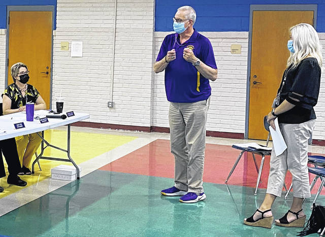 Greenfield Elementary Principal Bob Schumm and assistant principal Lindsay McNeal (right) speak to superintendent Quincey Gray (left) and the Greenfield Board of Education at Monday's meeting.
