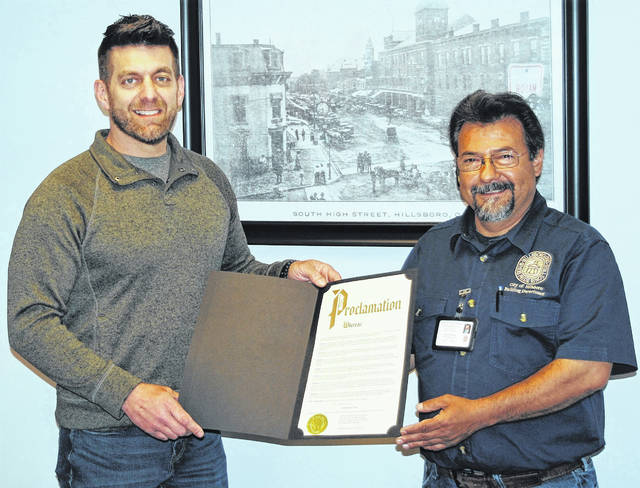 """Confirming a city commitment to recognizing that Hillsboro's growth and strength depends on the safety and economic value of the homes, buildings and infrastructure, mayor Justin Harsha said Monday while issuing a proclamation designating the month of May as Building Safety Month in the city. """"Safer buildings, safer communities, safer world"""" is this year's theme. Shown in the mayor's office are Harsha (left) and Hillsboro Chief Building Official Steve Rivera."""