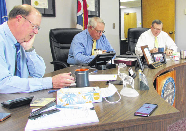 From left, Highland County commissioners David Daniels, Jeff Duncan and Terry Britton are pictured at Wednesday's meeting.