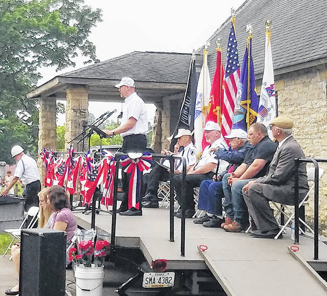 Former U.S. Marine Shaun Stevenson spoke at the cemetery during Greenfield's 2019 Memorial Day ceremony. World War II veteran and grand marshal of the parade, Ed Robinette, was seated third from the right.