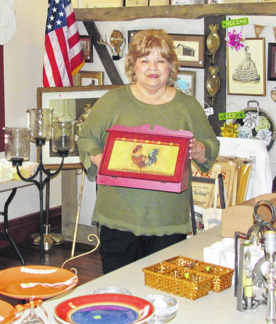 Highland County Historical Society Event Chair Jean Fawley stands among some of the many items for sale during its second annual Summer Bazaar and Yard Sale, scheduled for Saturday from 8 a.m. to 3 p.m. at the Highland House Museum in Hillsboro.